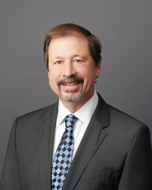 A professional headshot of Joe Mikrut, a Partner, at Capitol Tax Partners.