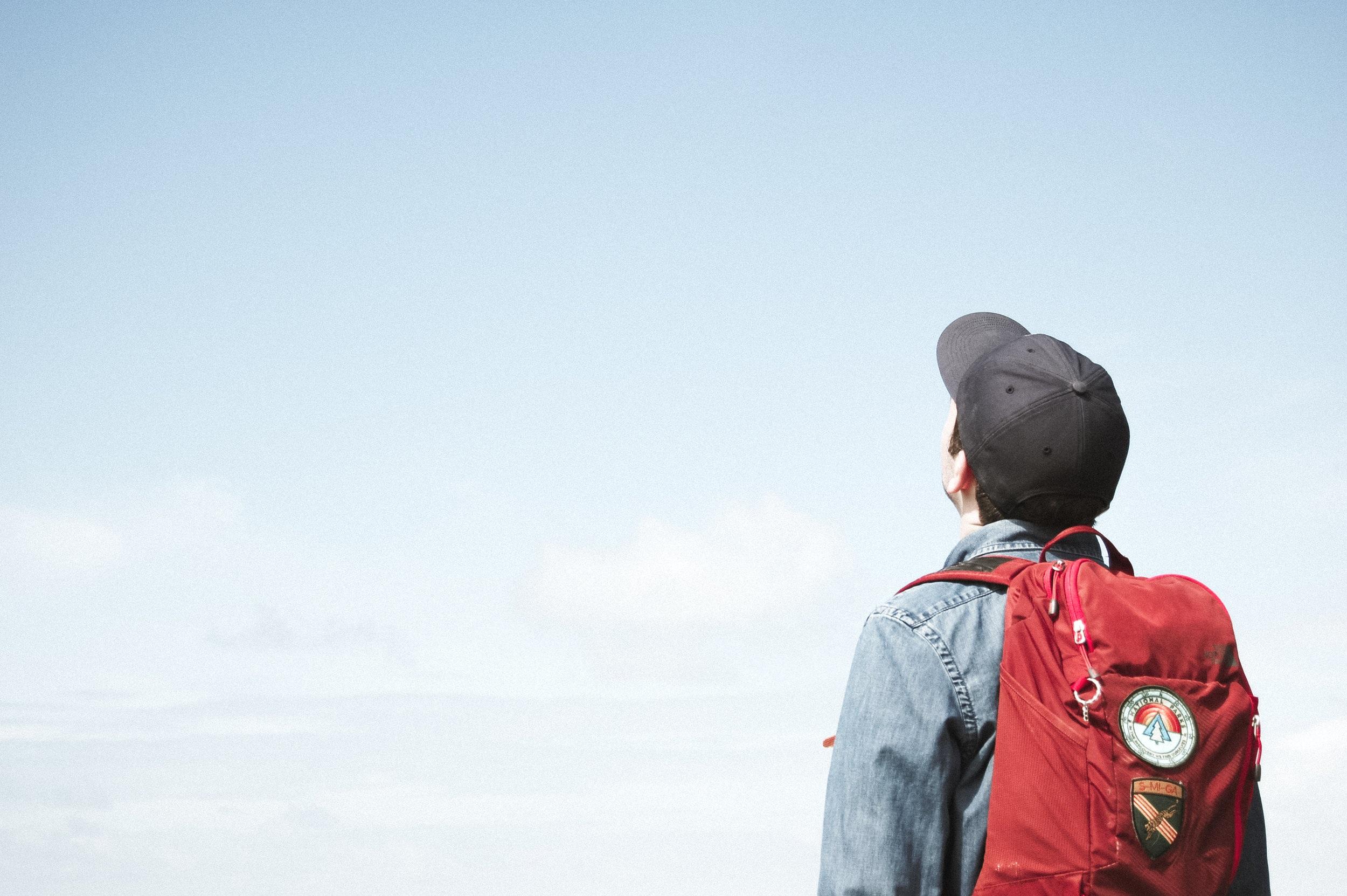 present man staring at sky