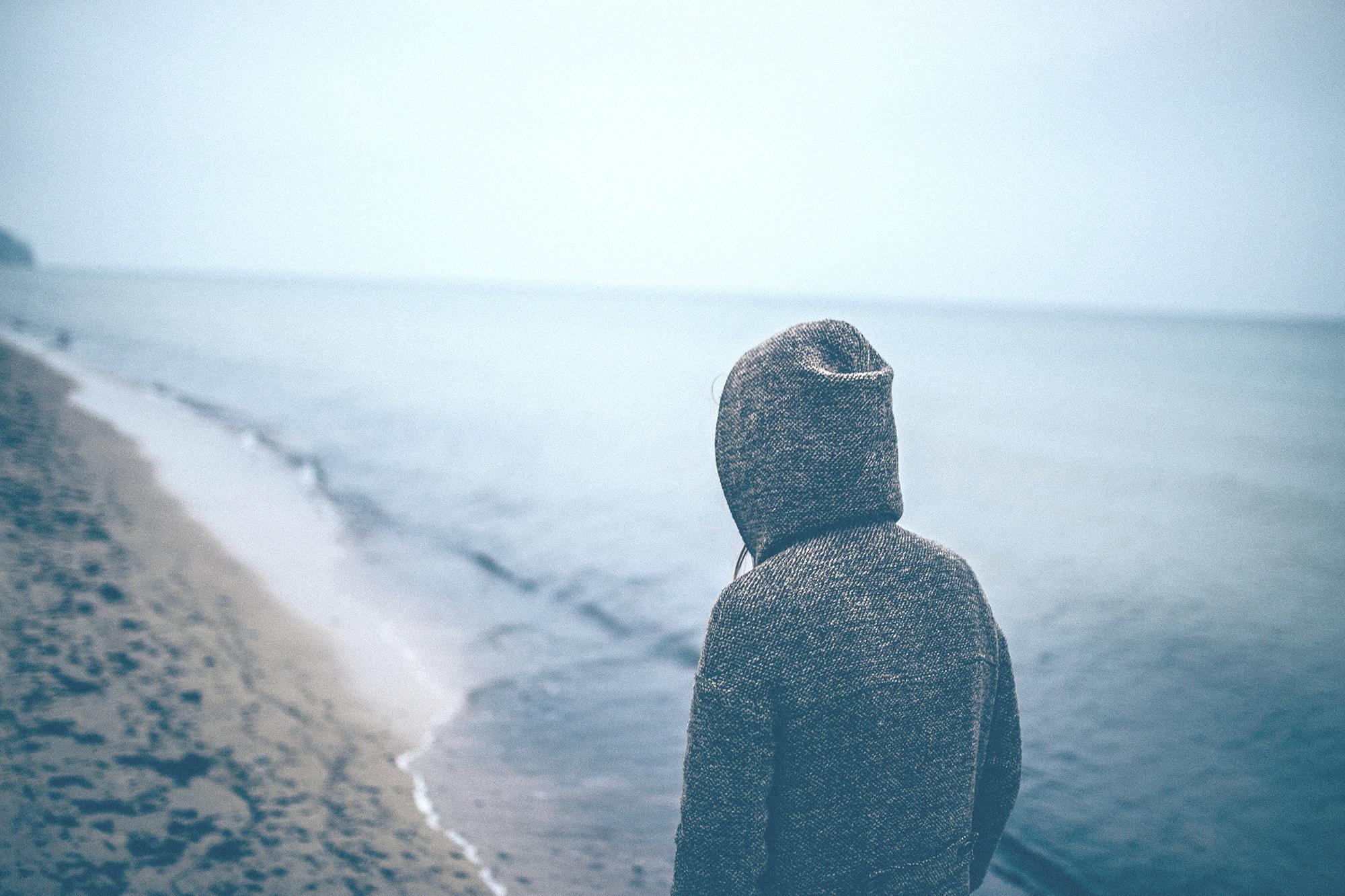 depressed man at beach