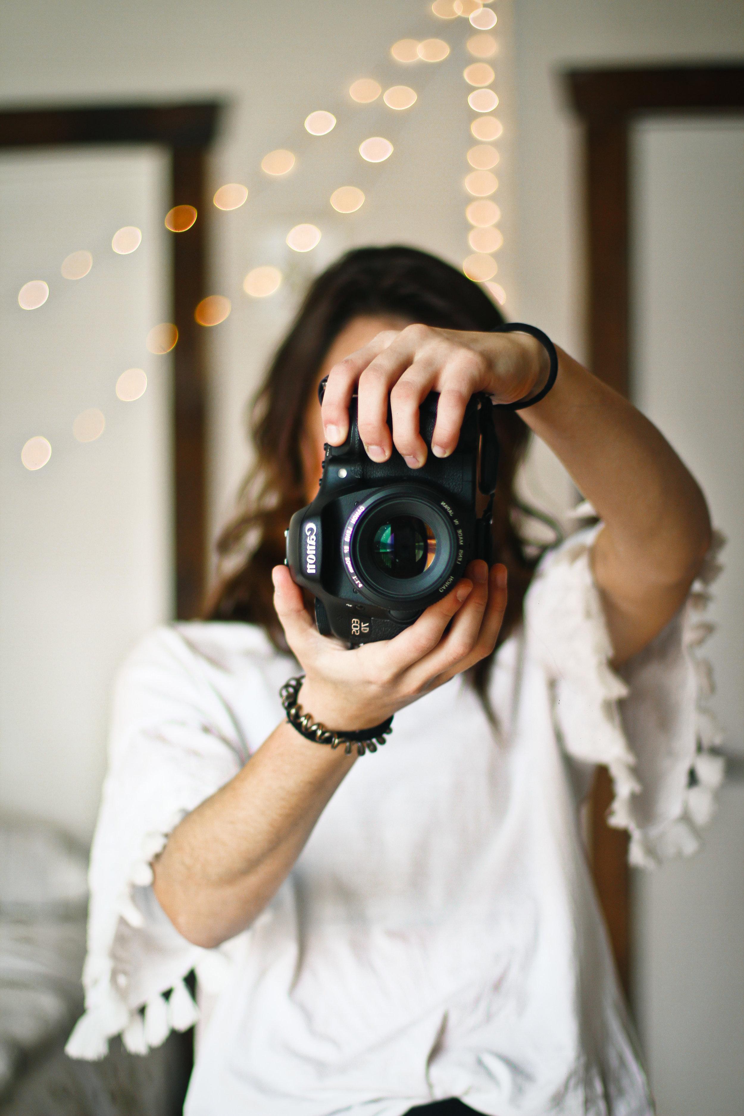 girl taking a photograph