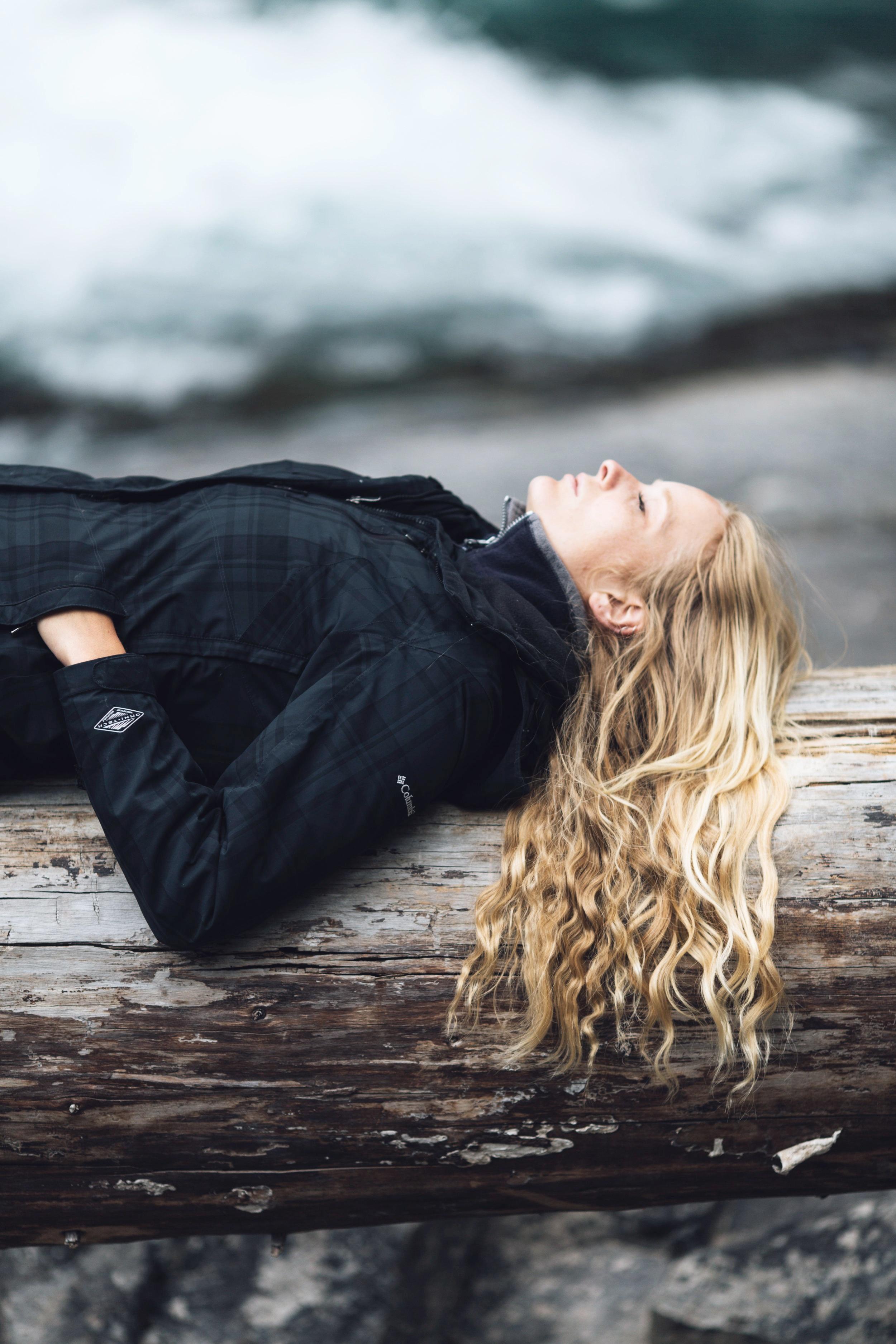 woman laying down and meditating