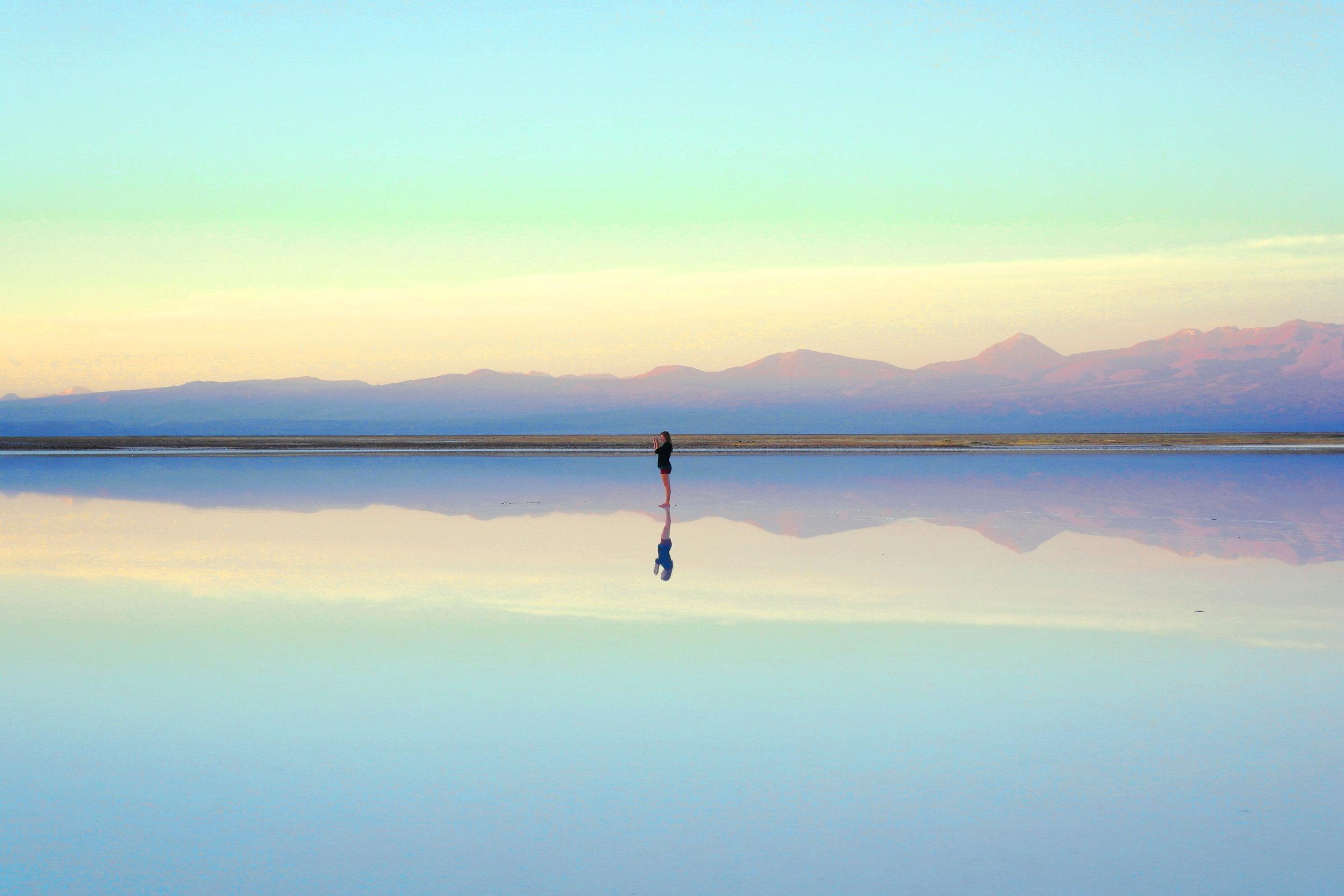 woman on salt flat reflection