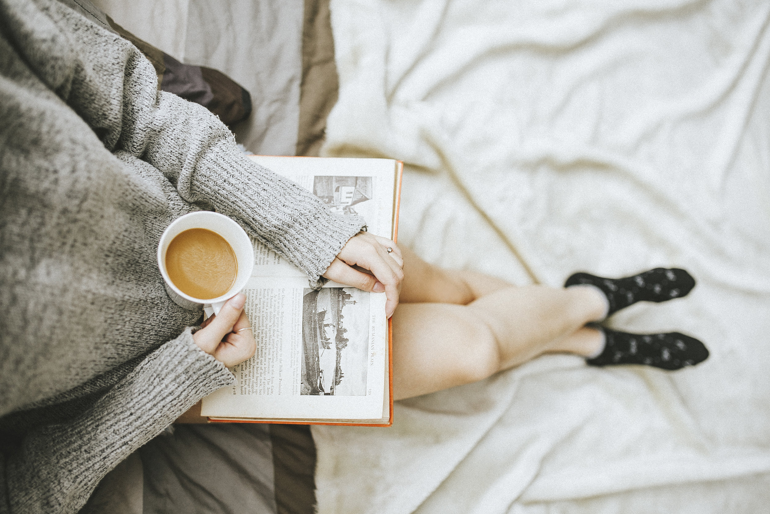 woman relaxing with tea and a book