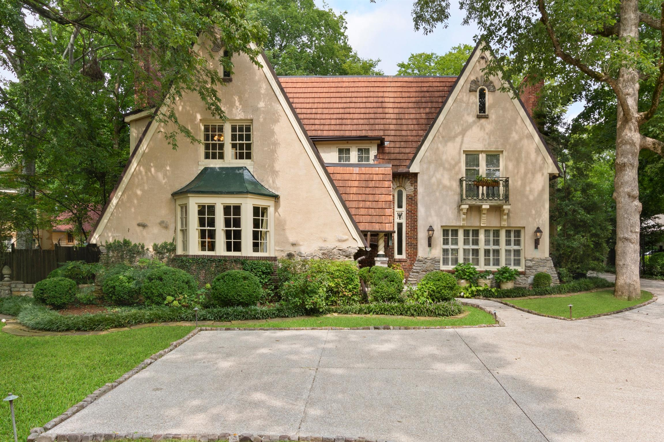 Storybook home in quiet corner of Belle Meade . This one has a stunning entrance that appears as if Snow White herself could walk out at any moment.