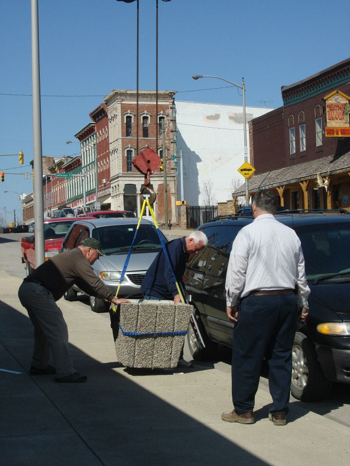 Main Street Volunteers placing Flower Planters on Sidewalks
