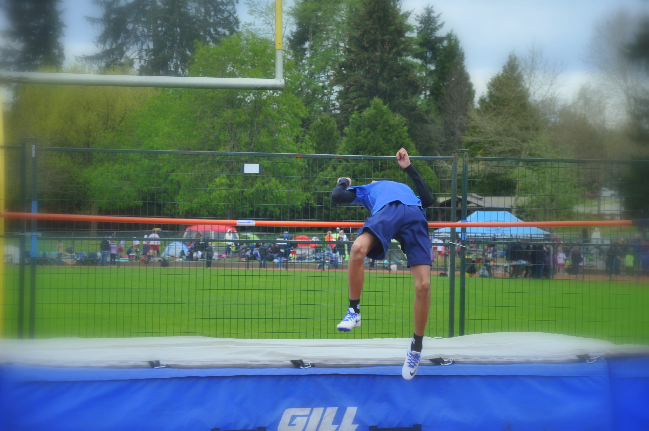 Immaculate Conception Storm team member with perfect form over the high jump bar.