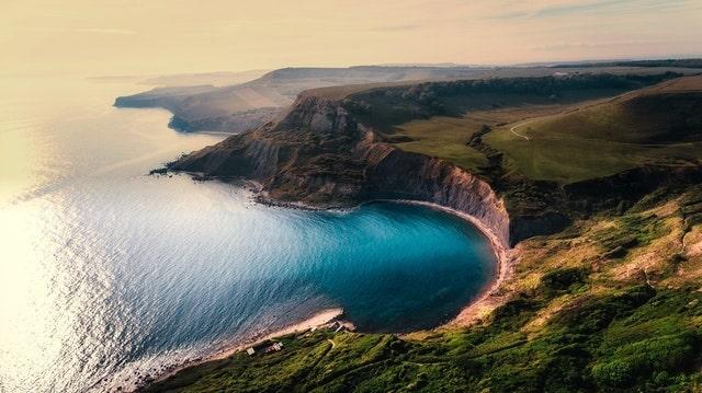 Satu-Korby-aerial-view-beach-cliffs-min.jpg