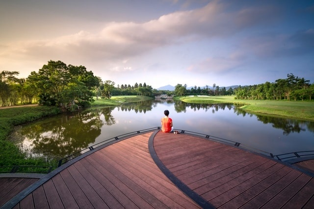 Satu-Korby-lake-dock-person-trees-clouds-min.jpg