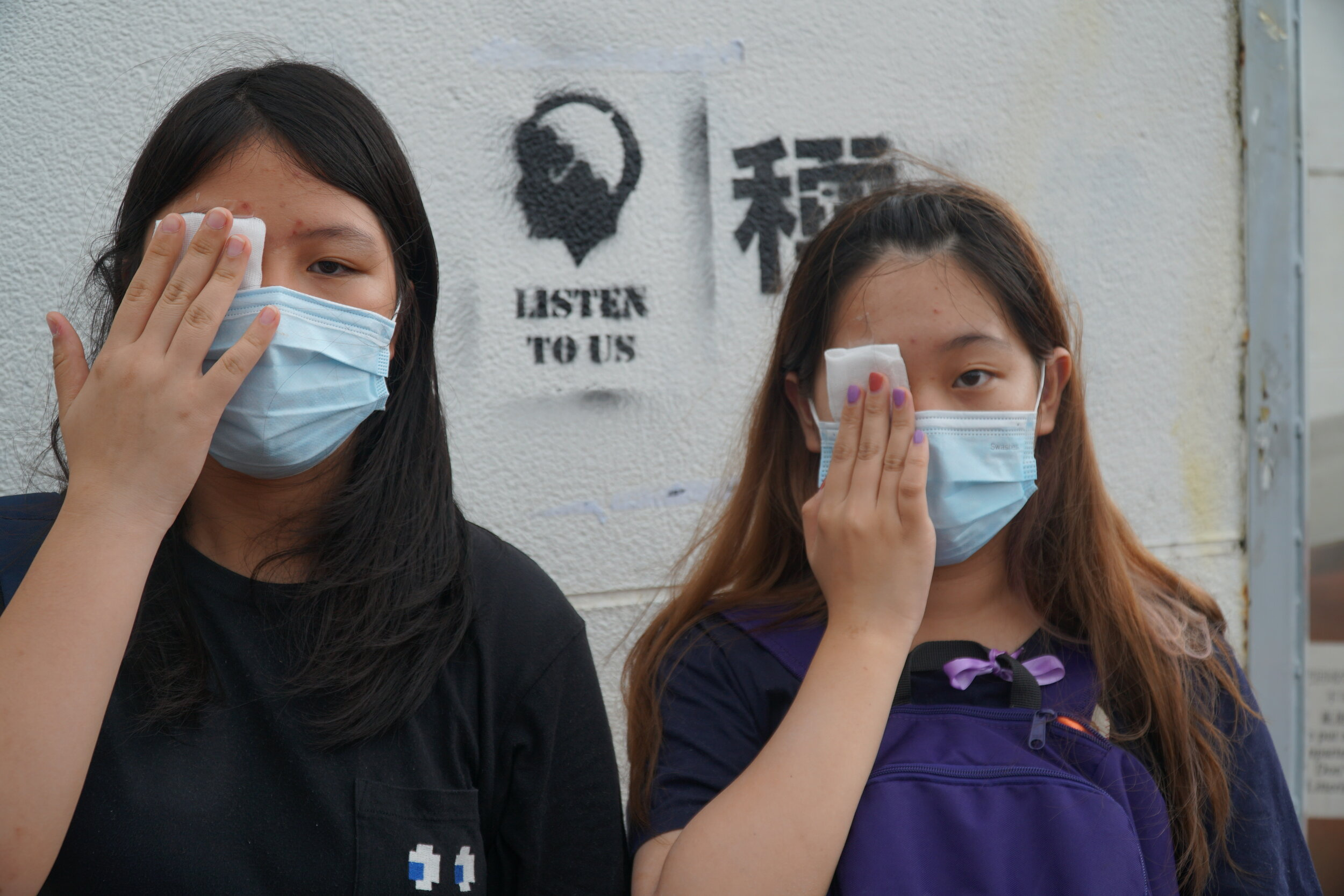 Students wear eye patches to show respect for a nurse who lost her eye during the protests