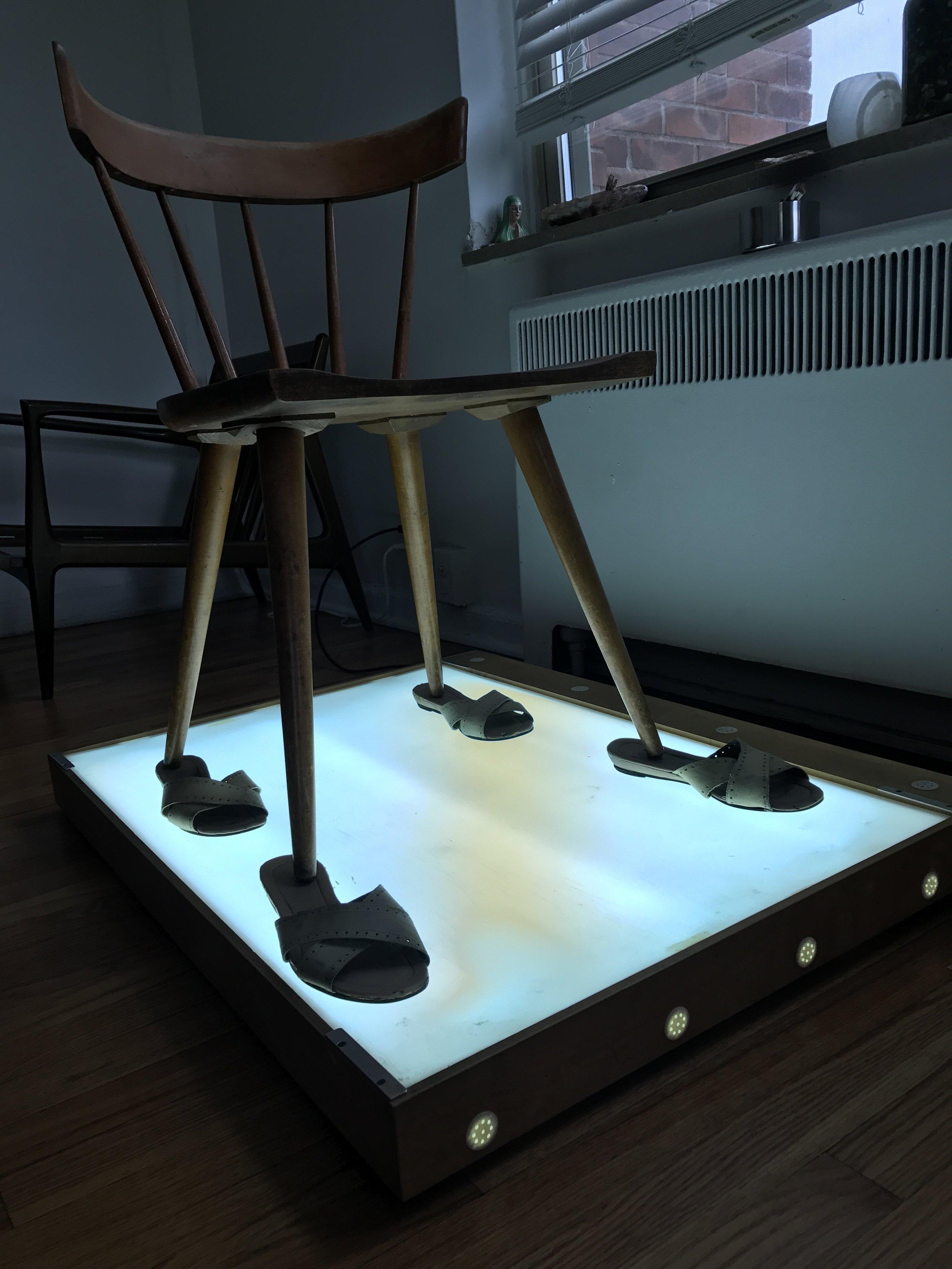 Thinking Like Julia Klein , 2017  Paul McCobb chair, light box, Egyptian leather sandals