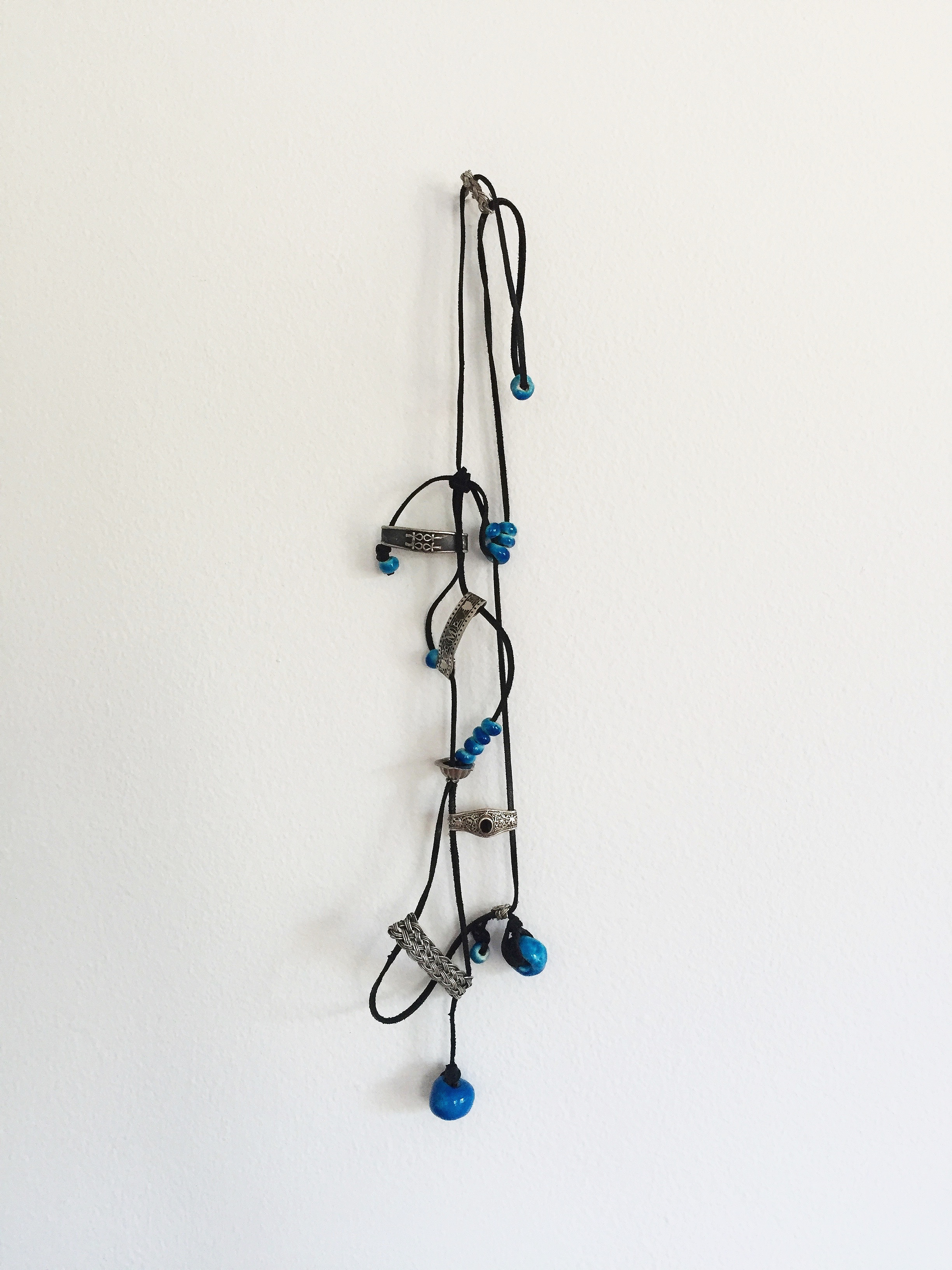 Souvenir , 2016  leather cord, silver rings, ceramic beads