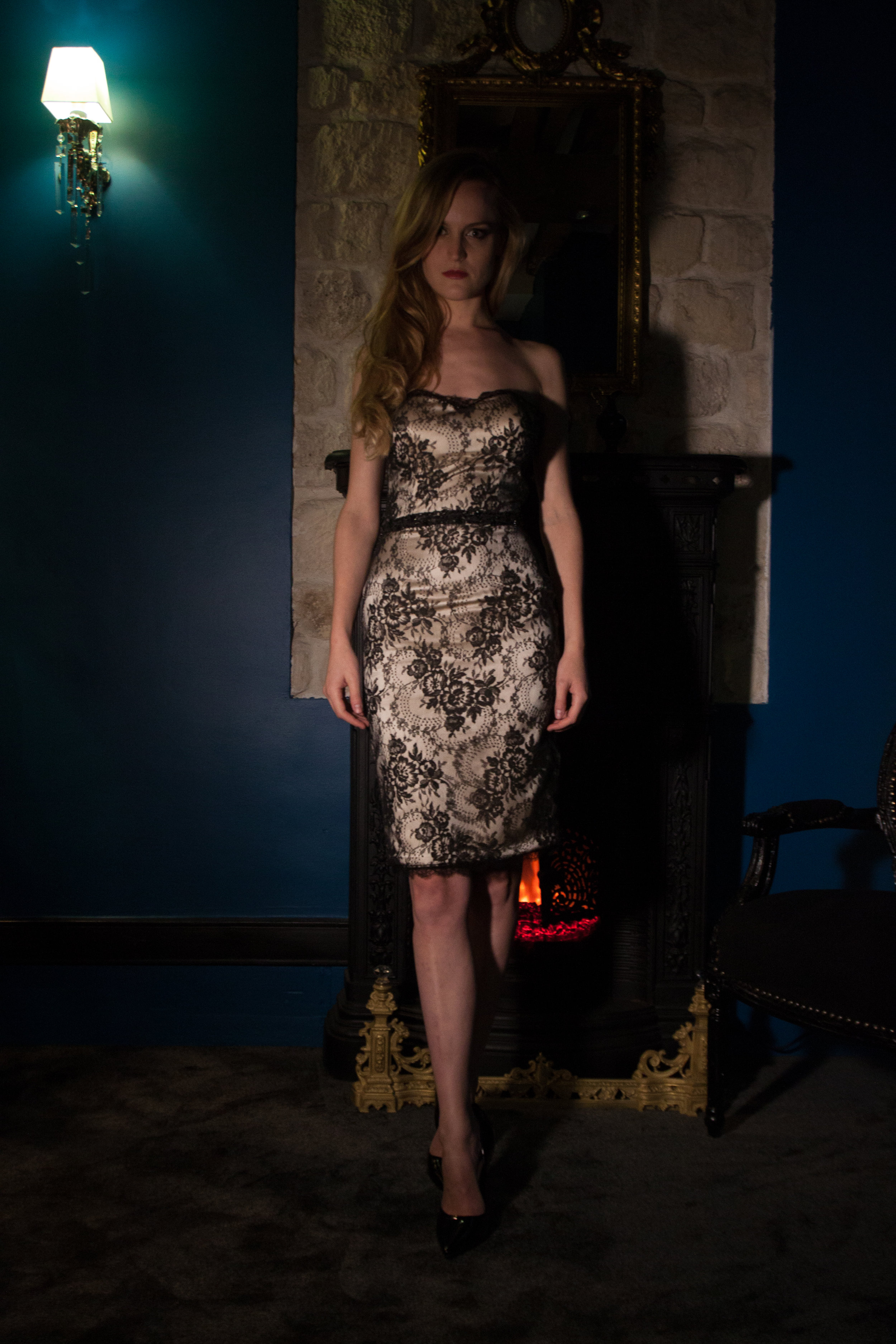 CAMILLE. Black dress with Calais lace on ivory satin. The patterns are enriched with a delicate black seed bead embroidery faceted and dotted with small flowers made of jet.