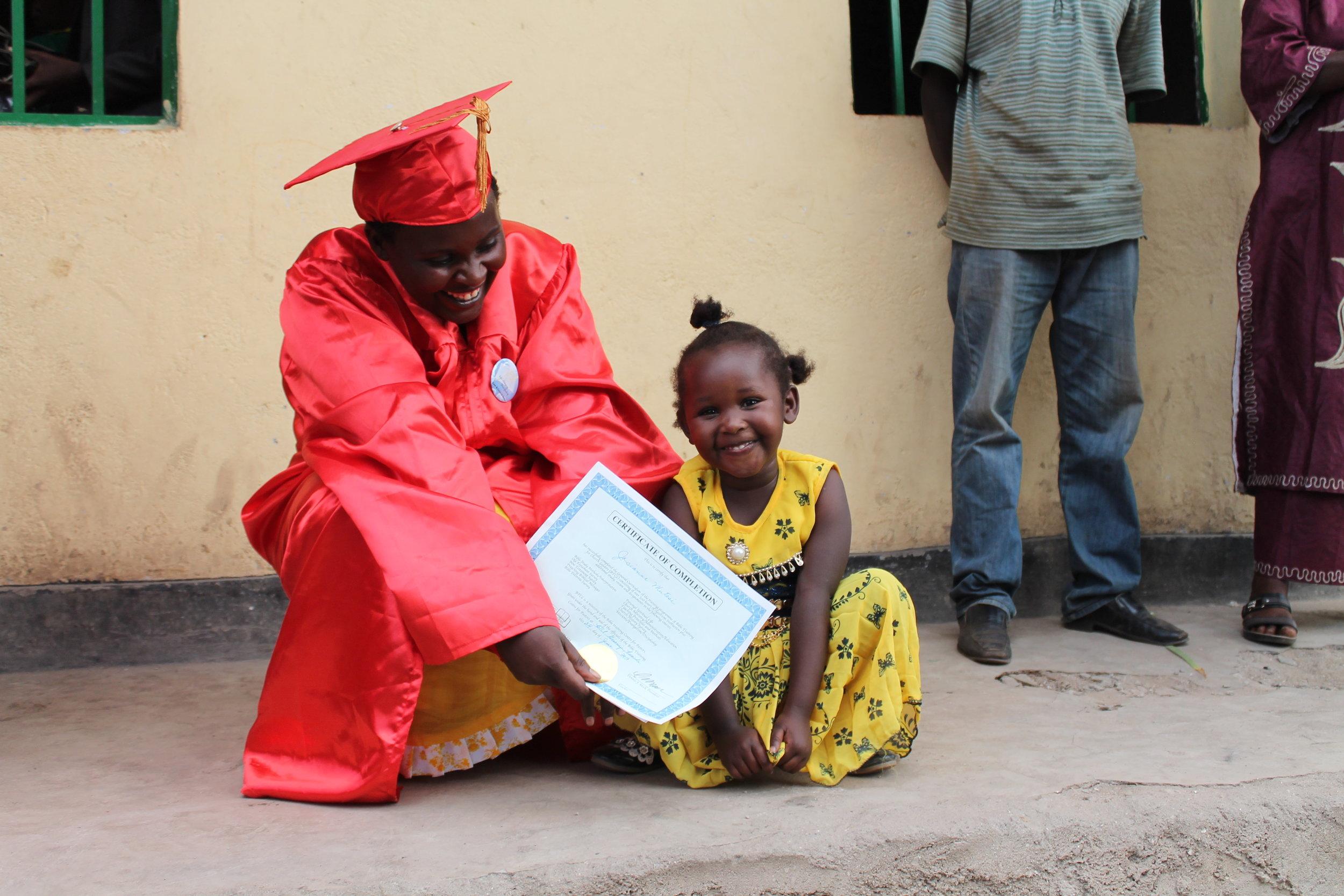 female-lady-btcl-graduate-and-child-rwanda-church-bible-leader.jpg
