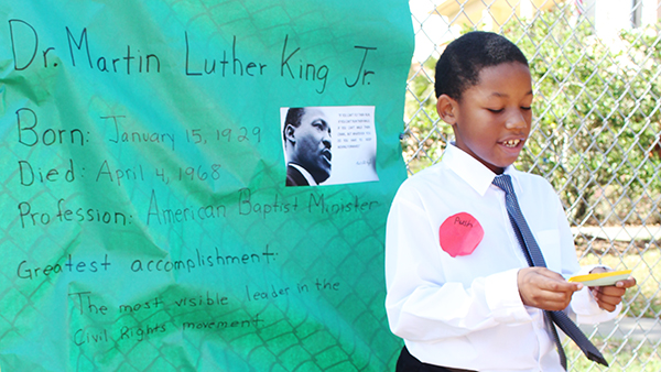 """A UCP Pine Hills student presenting the biography of Dr.Martin Luther King Jr. as part of his """"Living Museum"""" project."""