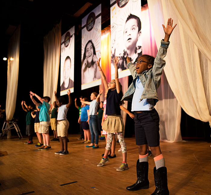 UCP Charter School students build confidence, motor skills, and language skills rehearsing for a performance.