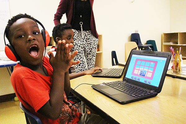 UCP Charter School student celebrating learning gains through an interactive game.