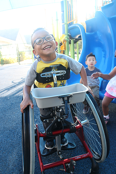 A UCP Downtown/BETA student plays with peers at our inclusive and accessible playground, giving all students the opportunity to engage in play together.