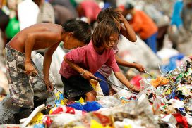 Kids looking around in the garbage dump to find ways to make money to just cover one meal for their family.
