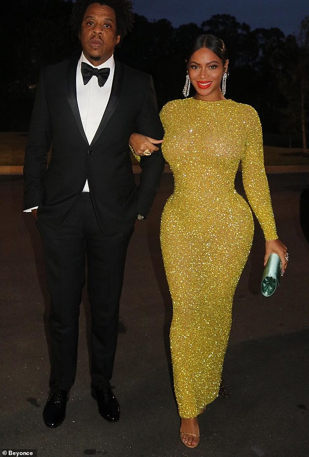 The Carters, Jay-Z & Beyonce on their way to the studio opening gala. - Image courtesy of Daily Mail UK