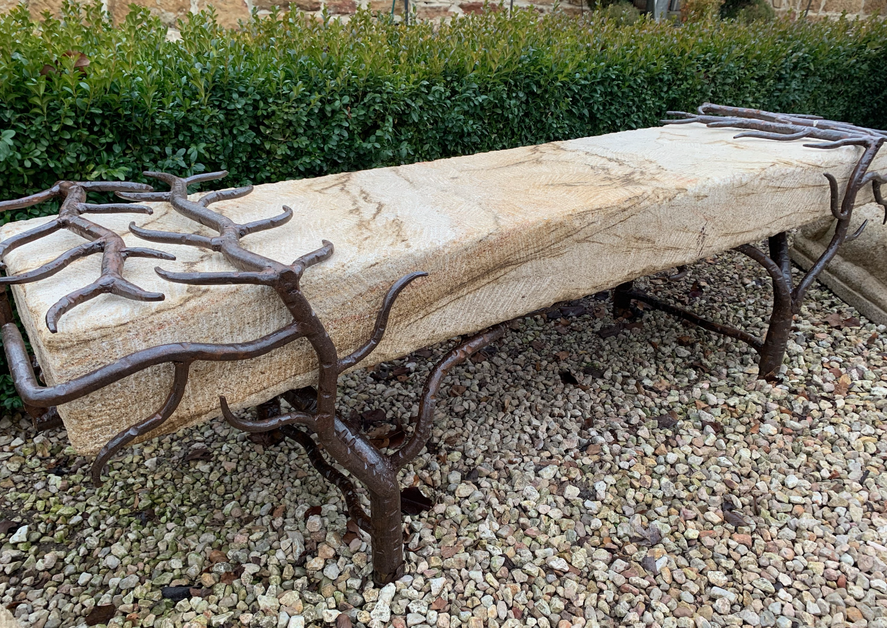 SB1554 Natural garden seat with forged iron ends and stone seat  $1395 out of stock