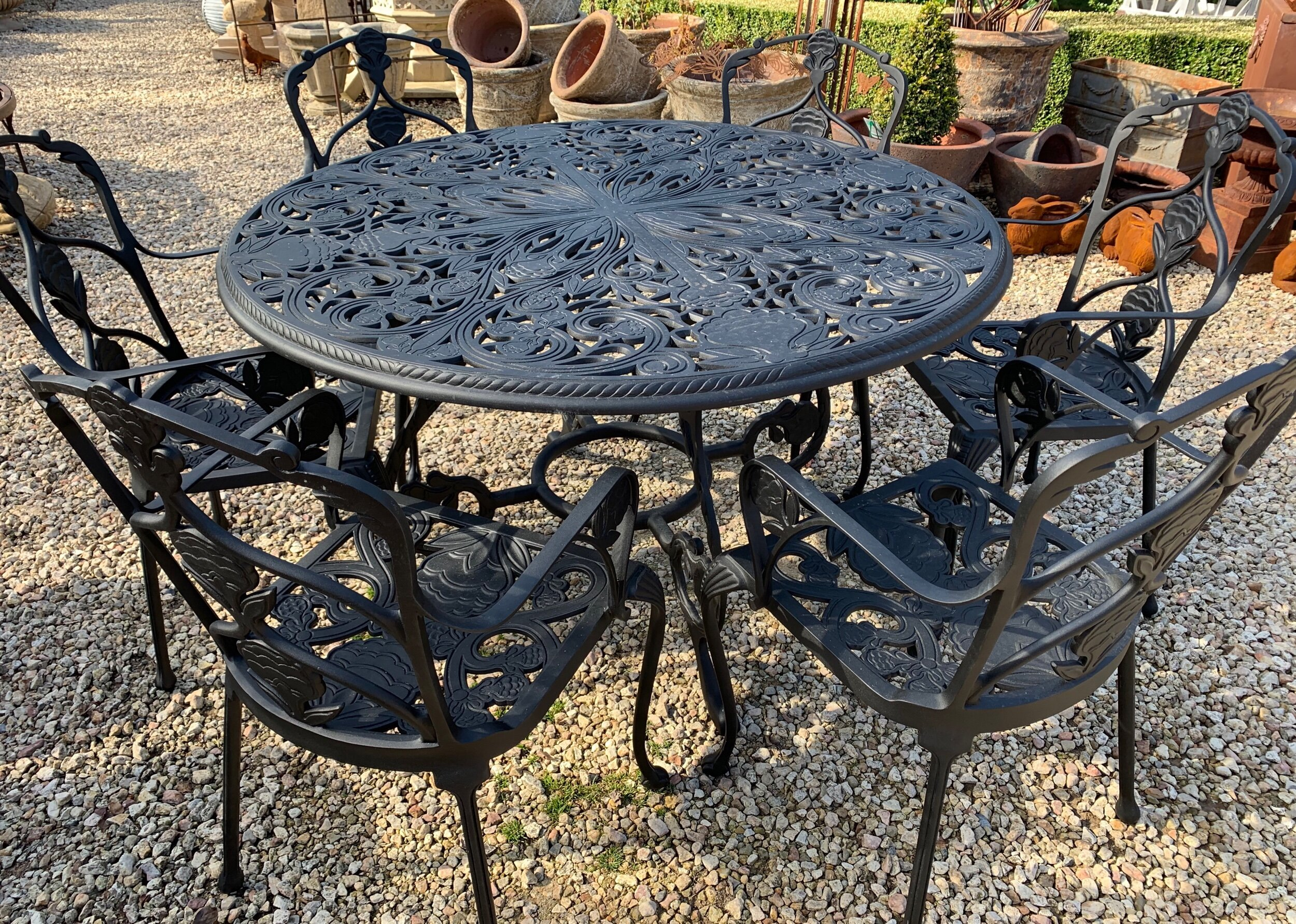 TC2011a-2012 Jekyll six seat cast aluminium table and chair setting $5800set