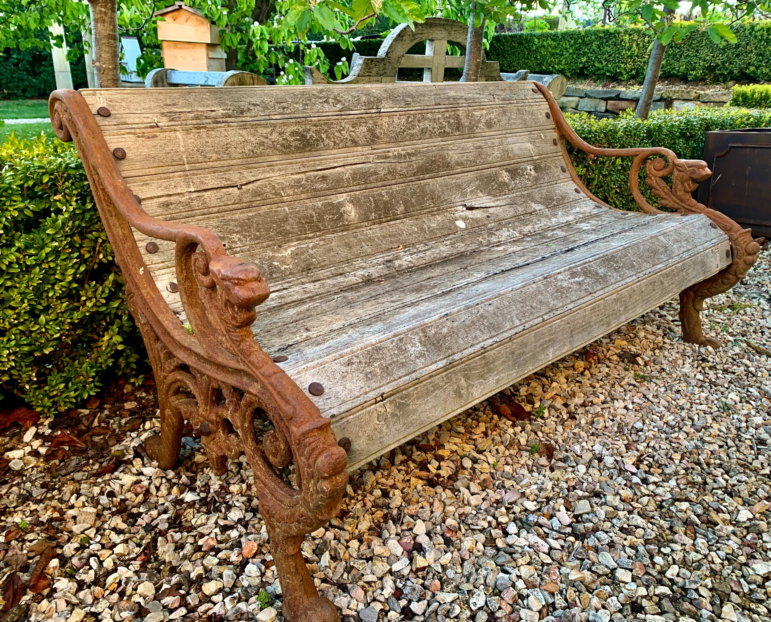 SB Three seater Griffin garden seat with cast iron ends and teak seat  $1195