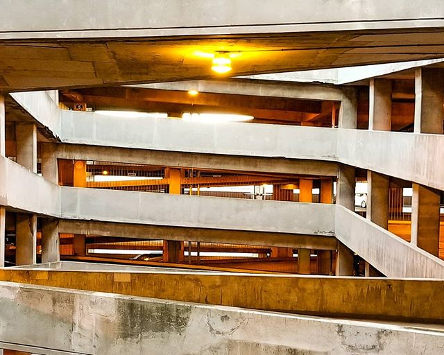 #Angles upon angles.  The south ave parking garage opened in 1974 (razing a large area of the old Theatre District), serving the surrounding area, including #MidtownPlaza, #Riverside Convention Center, #Hyatt Hotel, and other hot spots.  Most parking garages serve public needs quietly and inconspicuously, but the traffic angles and multi-story helix exit make for a unique urban space.  Coincidently, that helix exit made national news in 2006 when a large portion collapsed.  Miraculously, no one was hurt, and the garage was closed for renovations.  The helix was fully removed and replaced with the current #Cornerstone Park. ______________________________________ #ExploreRochester #RochesterNY #ThisIsRoc #IHeartRoc #585 #ParkingGarage #CenterCity #Midtown #TheatreDistrict #ExploreNY #ExploreUpstate #Downtown
