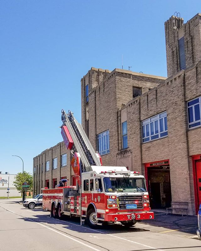 One of the most versatile stations in #Rochester, Engine 17/Rescue 11/HazMat 1&2 houses resources available to combat just about any calamity or challenge to the city. Originally the #firestation included the buildings across the street, where massive dual steer ladder trucks were garaged (think #Seinfeld and #Kramer manning the rear axle). Time and changing requirements for the modern #firedepartment saw those trucks disappear and more versatile #quints and  #aerialtrucks take their place.  The building itself is also notable for its #artnouveau inspired adornments, showcasing hoses, lanterns, firemen, axes, and rescue hooks.  Few of the old stations survive today, as they were torn down for new development, it is a great time capsule to see this one still in service to the community.  And as you explore the streets of #RochesterNY, keep a weather eye on old stations that have been repurposed.  There are about a dozen serving new uses, do you know where any of then are? Here's a hint, when's the last time you've been to a ballgame? ________________________________________ #ExploreRochester #ExploreNY #IHeartRoc #ILoveNY #WalkTheseStreets #CenterCity #BigRed #Firetruck #BlueSky #ThisIsRoc #Roc #585 #ExploreUpstate #Firefighter