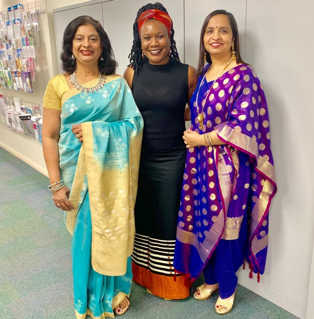 Ishar Multicultural Women's Health Services women dressed in traditional clothing. Supportive groups and activities for refugee and migrant women. Women working to promote health and wellbeing.