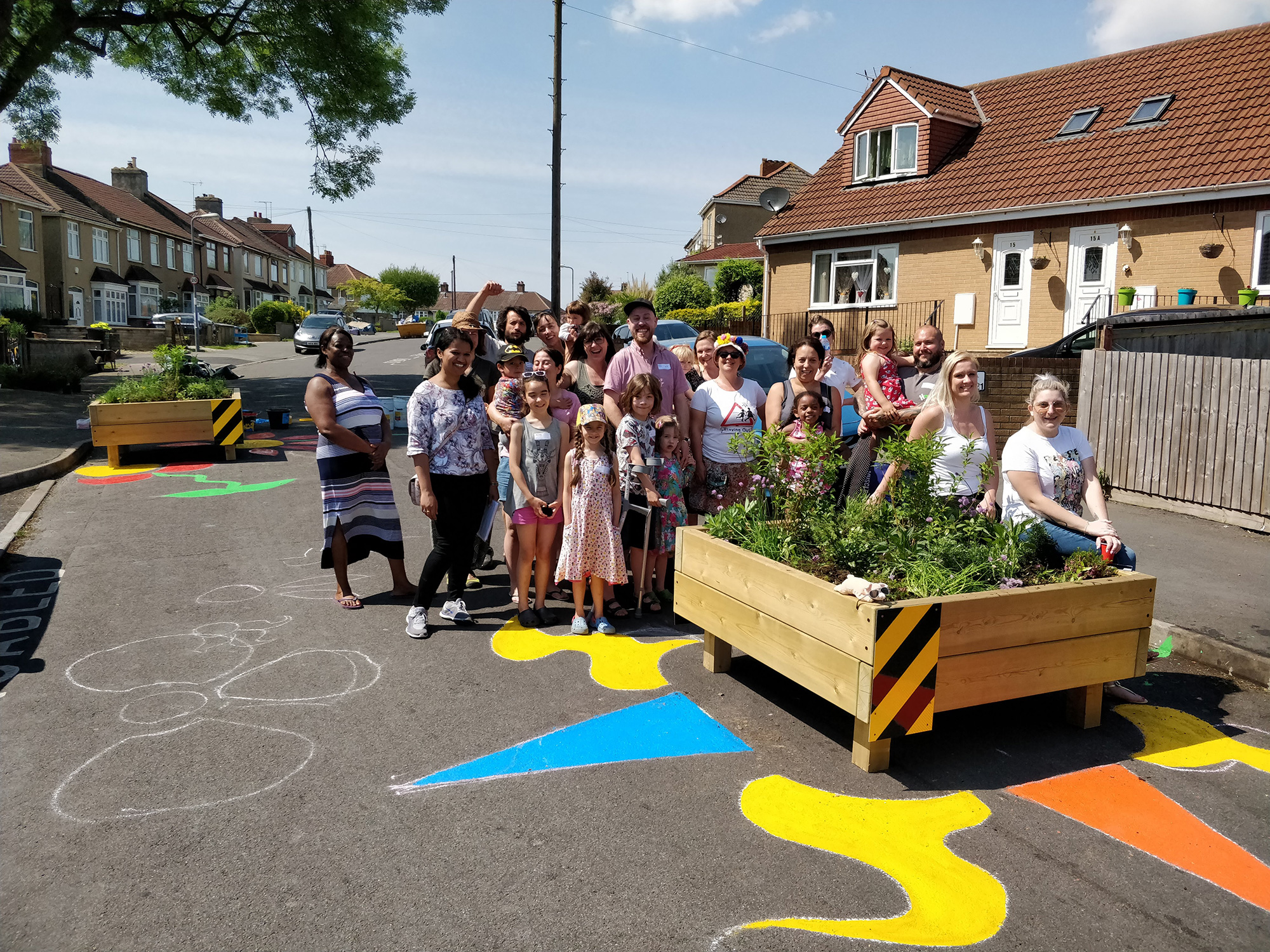 Local residents by their raised flower bed speed reducers