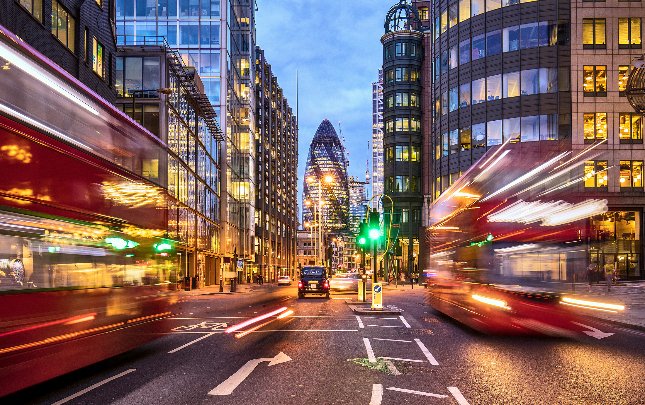 Buses, cars, taxis and pedestrians in London's financial district