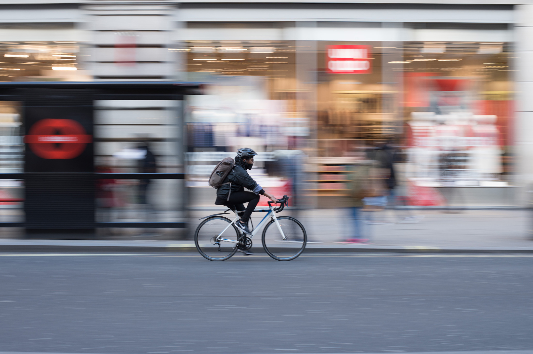 Timelapse of a cyclist in a city street