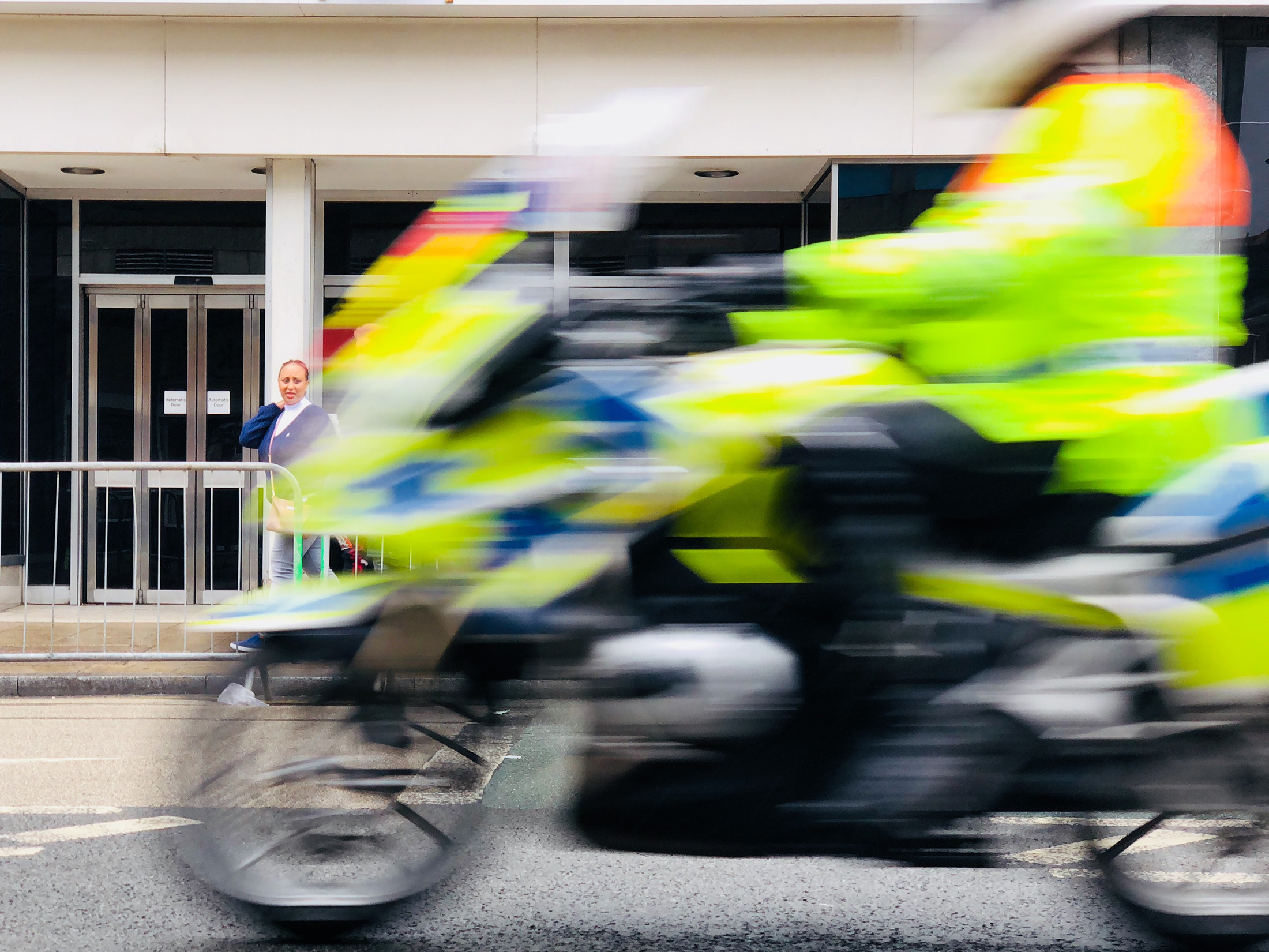 Police motorcycle rushing down a London street
