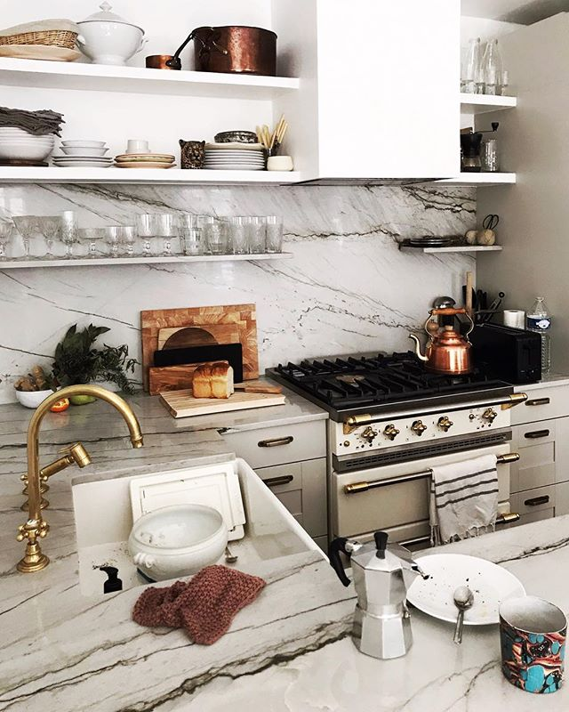 We love kitchens when they are imperfect, with dirty dishes and signs of lives well lived.