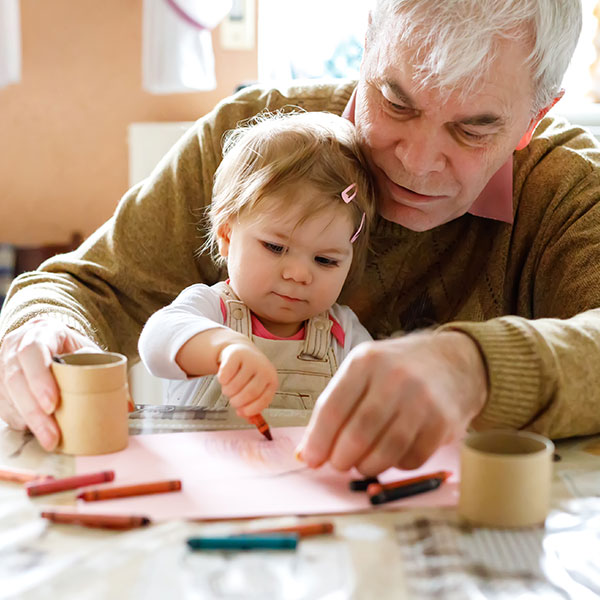 Grandfather drawing with child