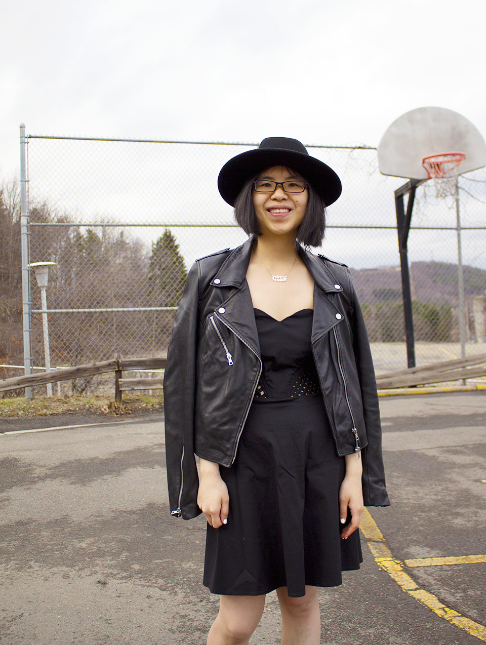 Classic and edgy all black outfit with black lattice dress, ZARA leather jacket, hat, and Opening Ceremony leather boots.