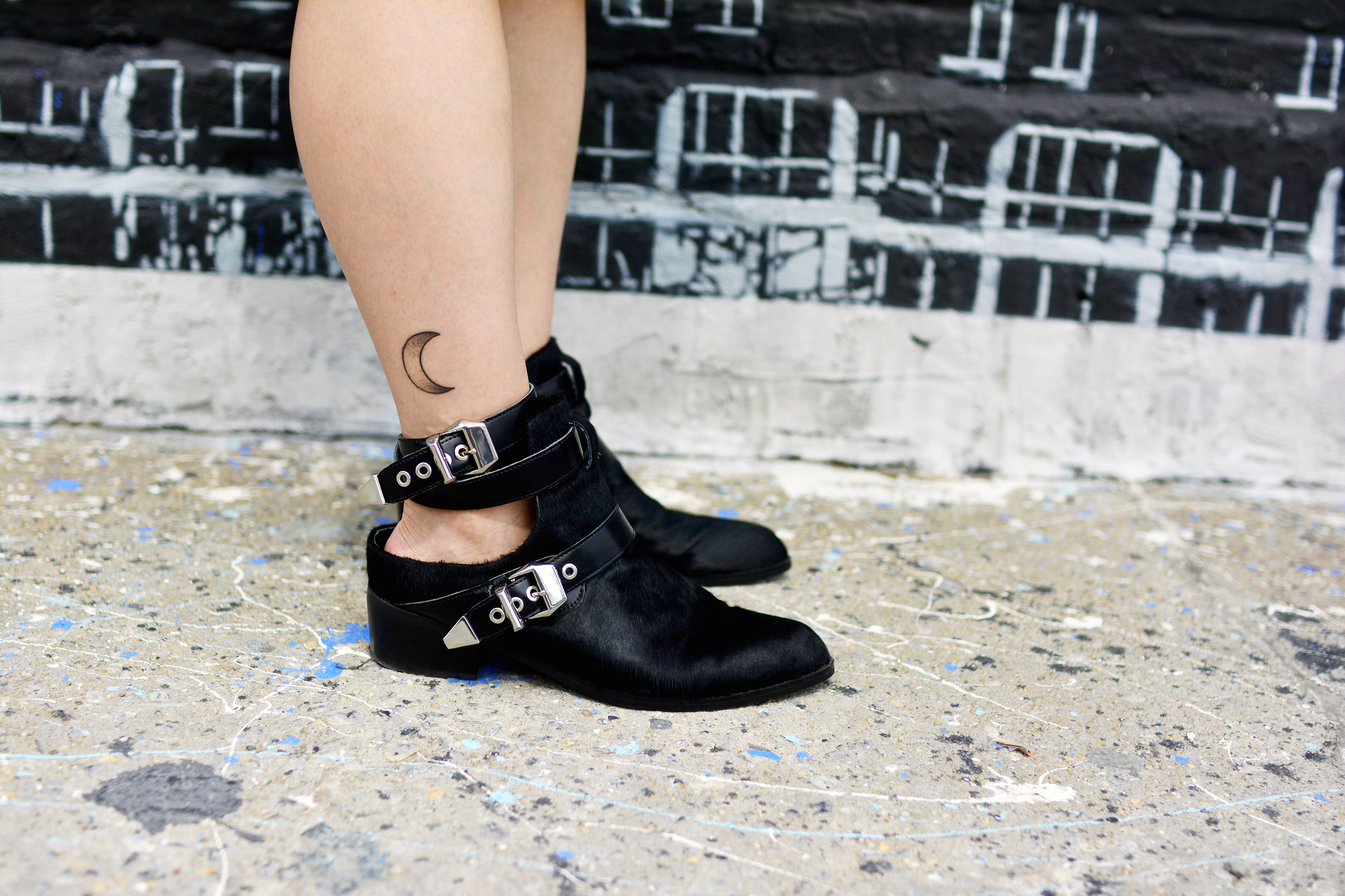 Discovering graffiti at the Welling Mural Court Project in Queens, NYC with a moon print dress, Sol Sana cut-out ankle boots and crescent moon tattoo