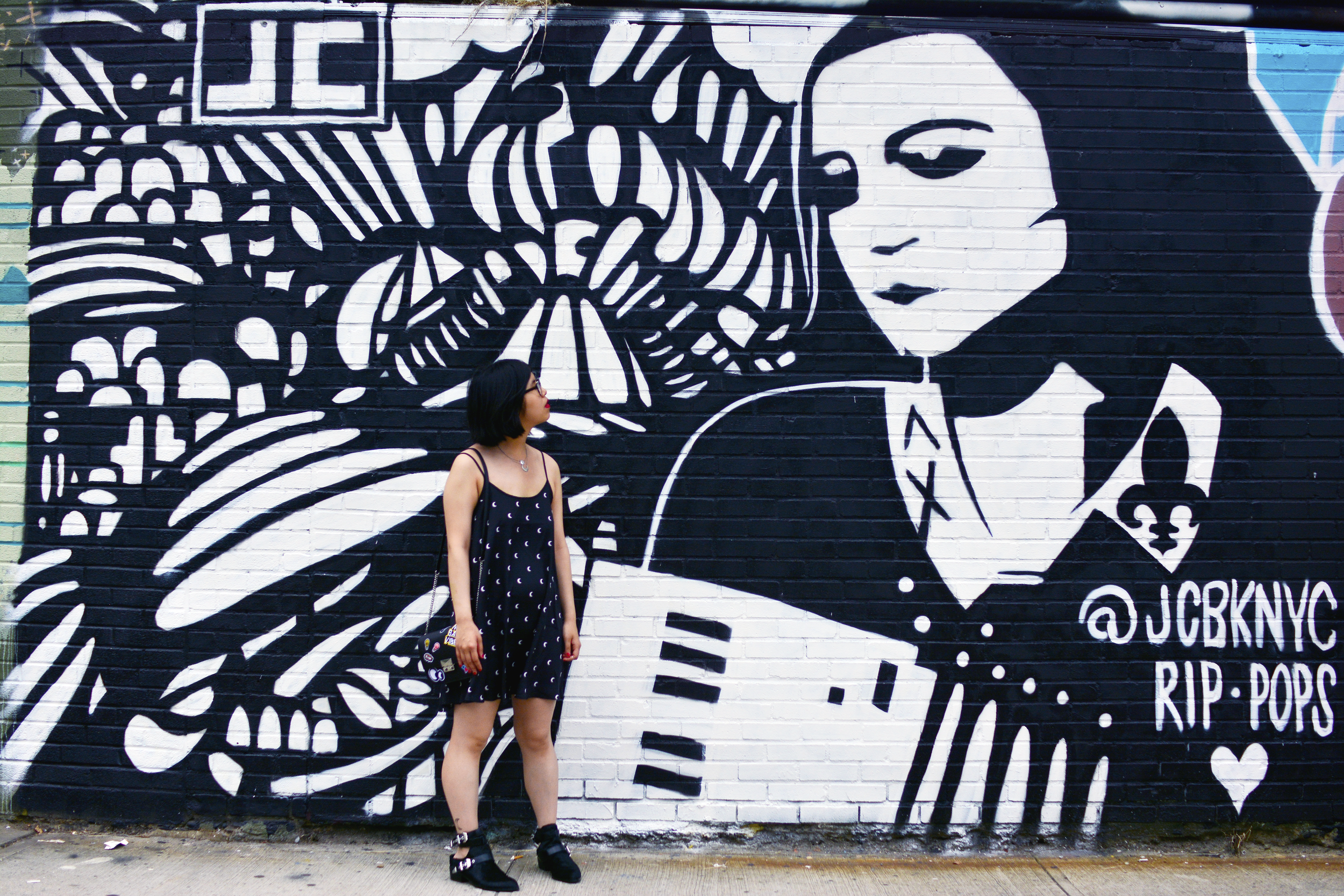 Exploring the Welling Court Mural Project 2016 in Queens, NYC. Discovering beautiful and powerful graffiti art in moon print dress.