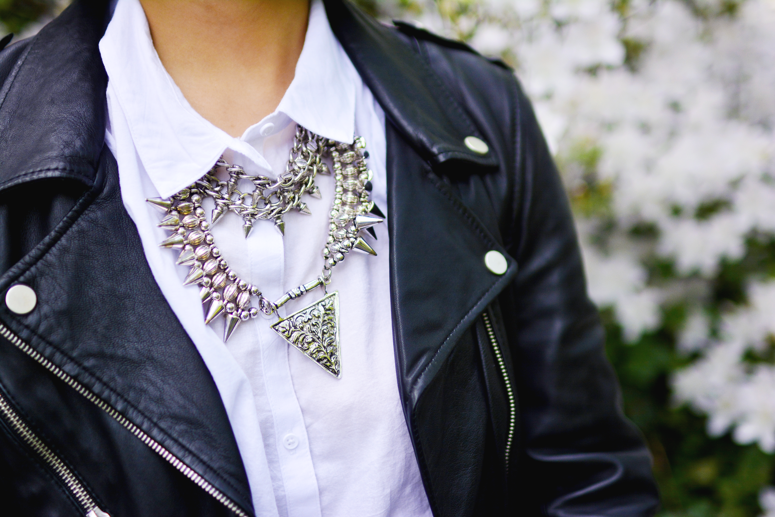 Claire Marshall's statement necklace - Just Wing It - and leather jacket