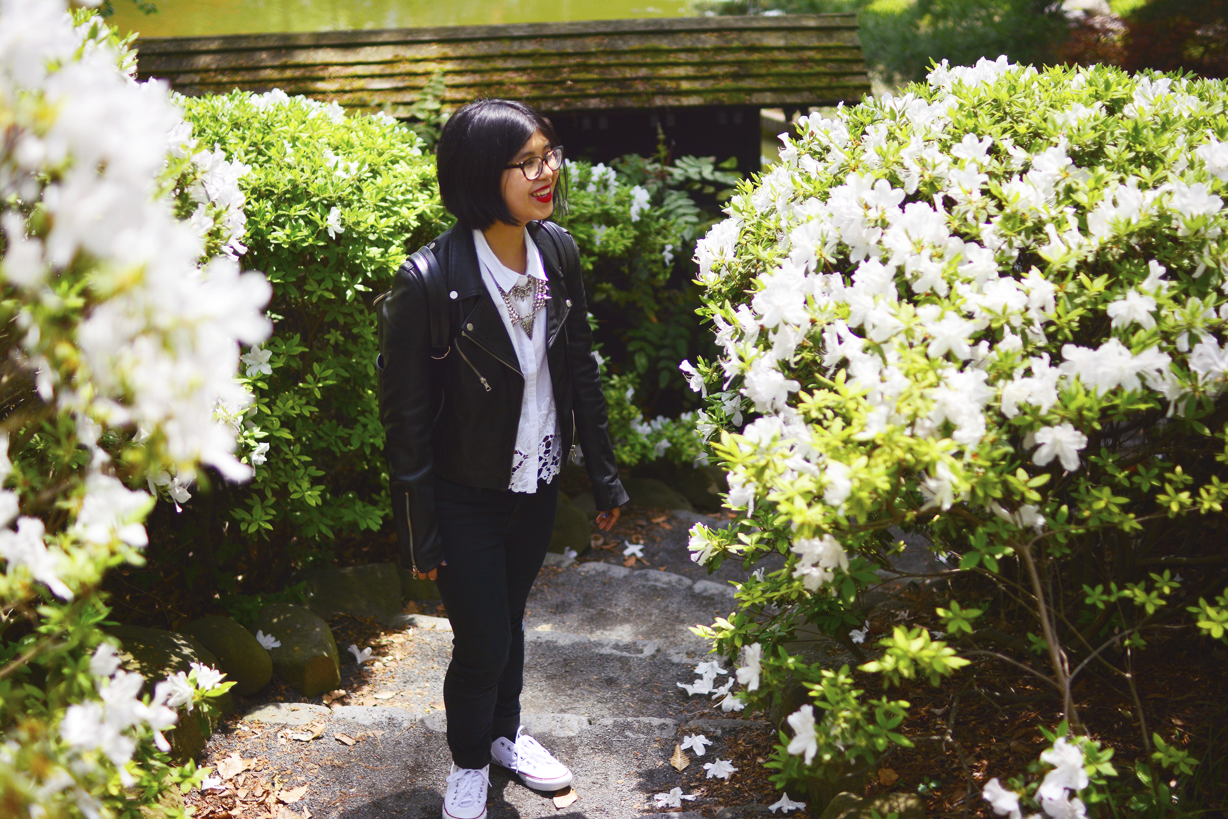 Edgy & classy outfit with floral cut shirt, leather jacket, Claire Marshall's statement necklace, and white Converses for trip to Brooklyn Botanical Gardens