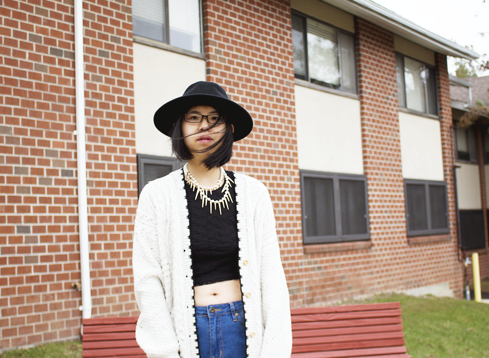Casual and comfy outfit featuring a pearl necklace with a chunky sweater, ripped jeans, and OpeningCeremony boots.