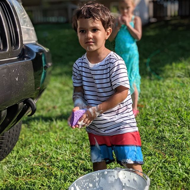 Car thoroughly washed, the power of suction discovered, popsicles eaten, blueberries gathered then eaten #straightfromtheblueberrybush, and a very shiny #jeep. #somuchoutsidetime #summersession2019  #splashday