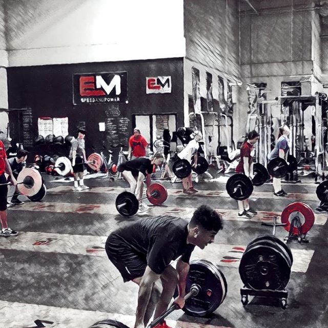 Weight training at EM Speed & Power's facility