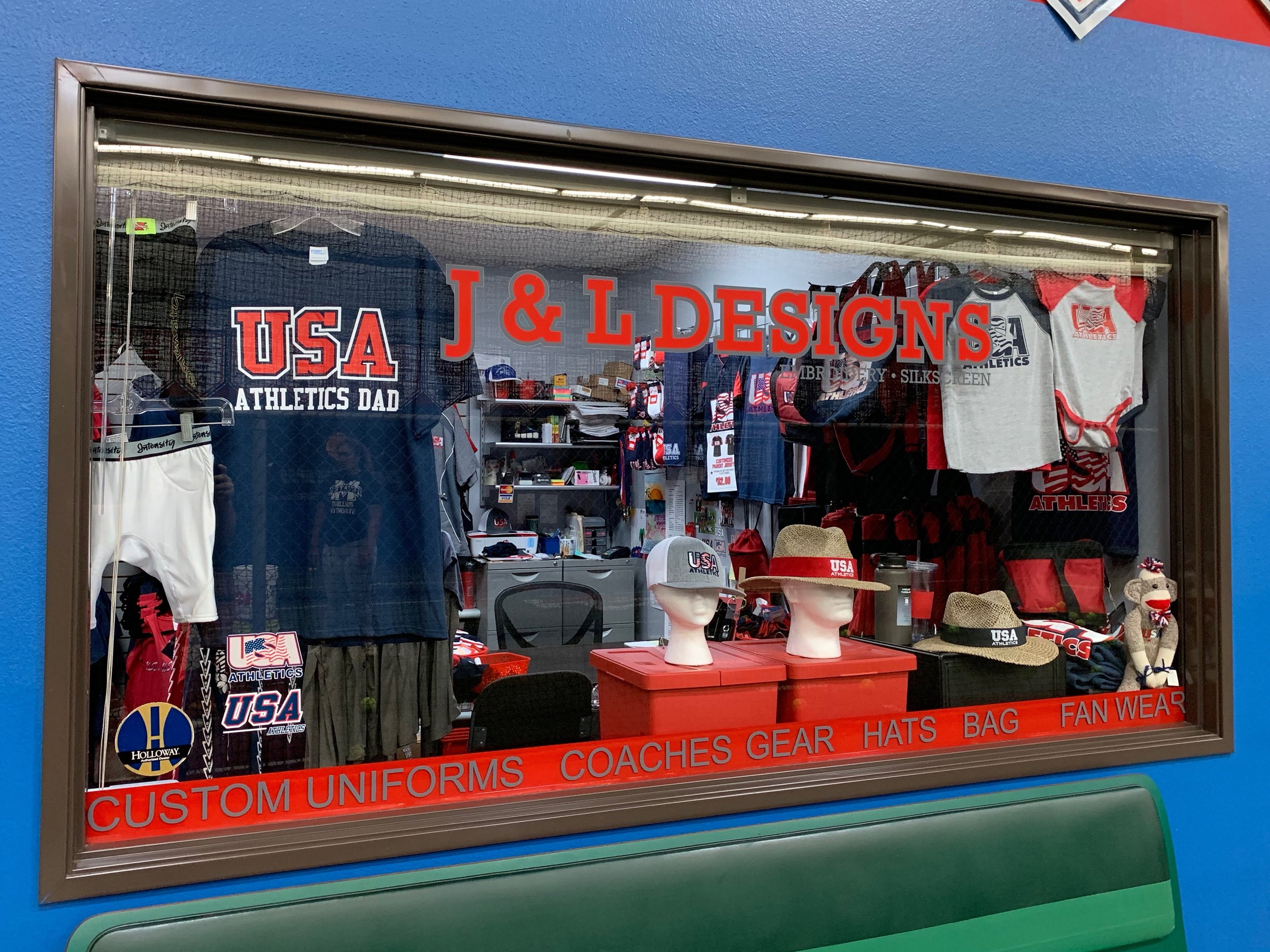 A look inside J&L Design's shop at On Deck in Long Beach. Featuring custom uniforms, gear for coaches, hats, bags, and fan wear.