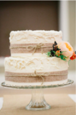 Layer ribbon and twine like this rustic wedding cake from the  Ruffled Blog