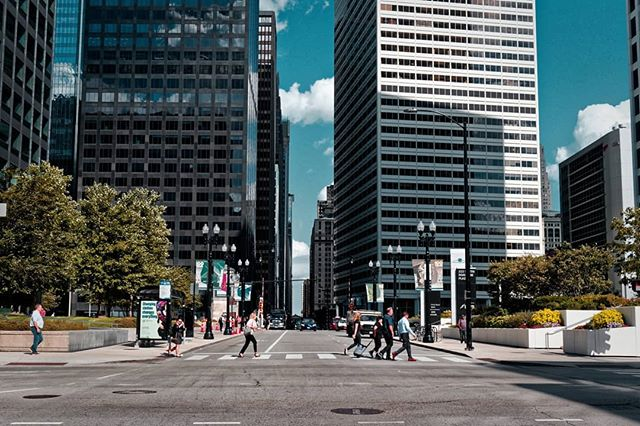 Crossing the street in Chicago.  Shot with the Canon M5 and Canon 22mm f/2 lens. Edited with #dxolabs Photolab and Filmpack 5.  #justgoshoot #chitown #citylife