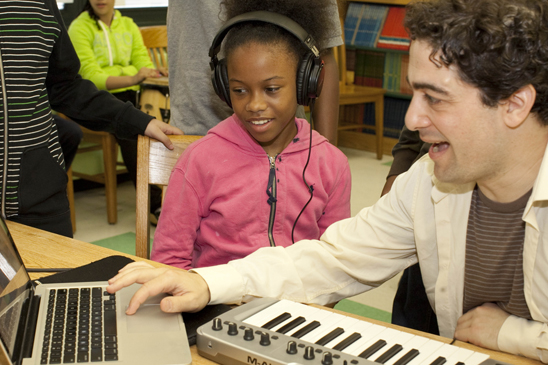 Working with students at PS 307, Brooklyn NY, on original song writing/recording