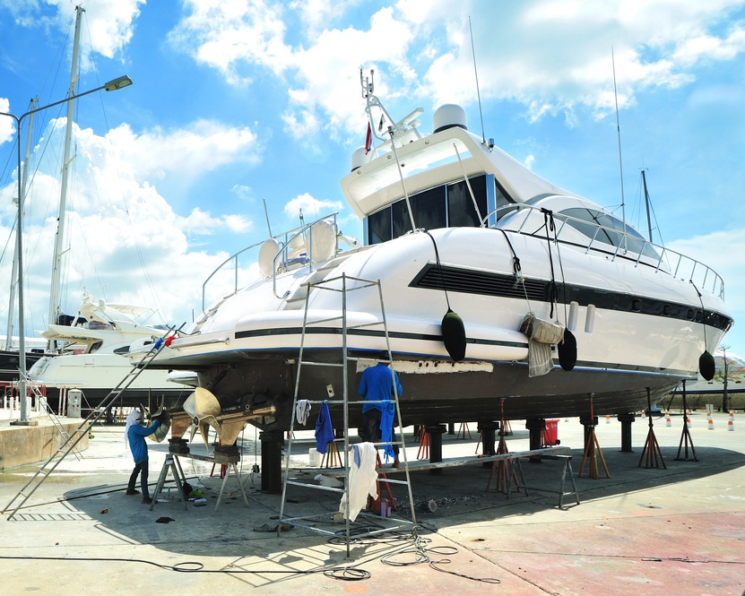 Luxury motor yacht in dry dock for repair. Artisan marine contractor insurance.