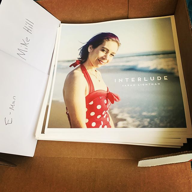 The posters just came in! There are just a few hundred. I better start signing these for the party before the CDs arrive! Who's excited to hang one of these bad girls on their wall? #poster #music #interludealbum #emergingartist #prerelease #music #singersongwriter @lunaguitar @cleartonestrings @empireears #artist #streetperformer #polkadotdress #purplehair #mydailylight