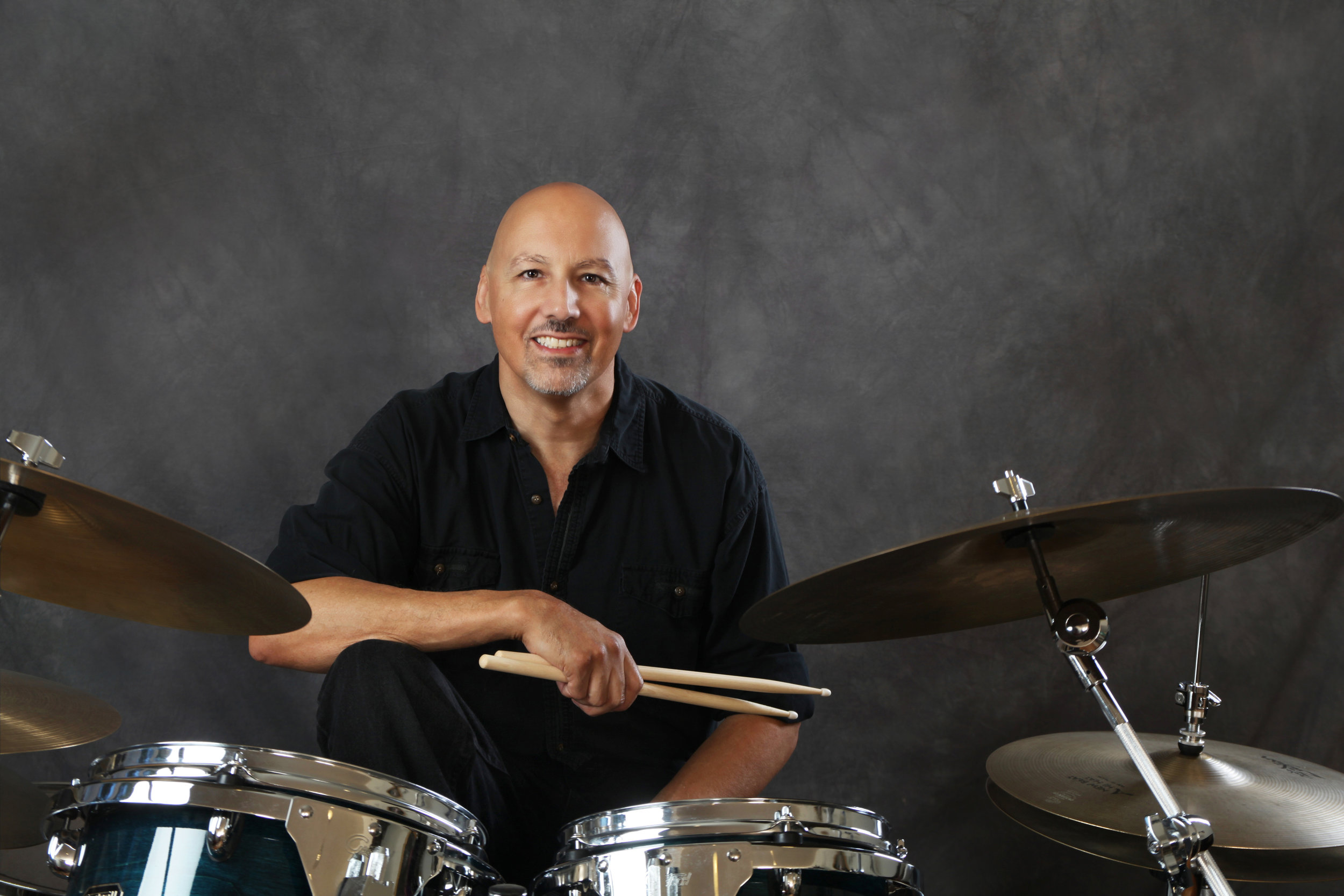 Ken - Ken's drumming career began in high school, where he earned the prestigious John Phillips Souza Award. He went on to study with legendary Jerry Steinholtz and Tom Brechtlein, named one of the top 500 drummers in the world. Ken has performed with multiple Grammy award-winning artists and regularly plays with the band Guilty Conscience.